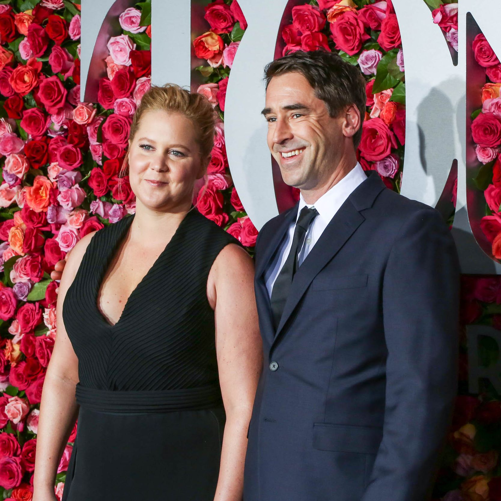 "Amy Schumer's Husband Chris Fischer Had ""Early Signs"" of Autism Spectrum Disorder"
