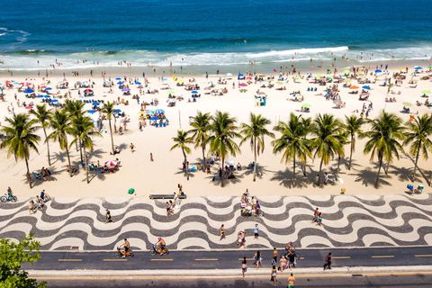 a sunny sunday at the beaches in rio de janeiro amidst high numbers of infected people by the coronavirus covid   19