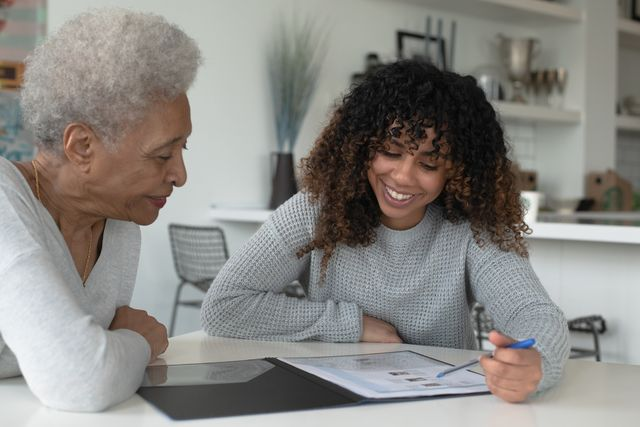 an african american adviser meets with a senior client stock photo