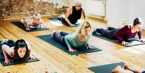 An Amateur Yoga Group Mid Pose