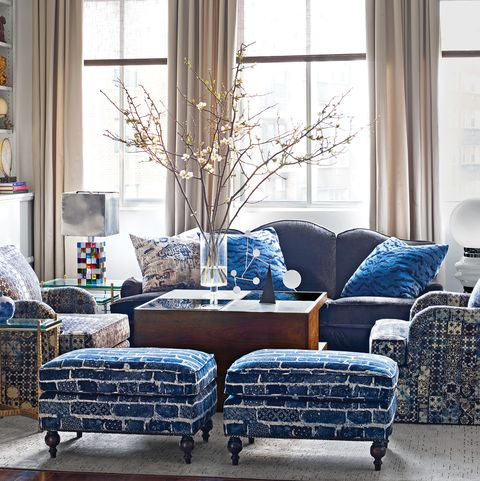 Living room with ottomans, chairs, and sofa in blue tones