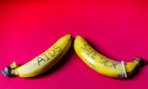 AIDS and Safe sex concept of condom on banana