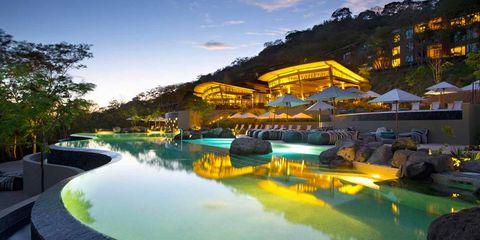 Swimming pool, Resort, Natural landscape, Leisure, Resort town, Water park, Real estate, Sky, Architecture, Landscape,