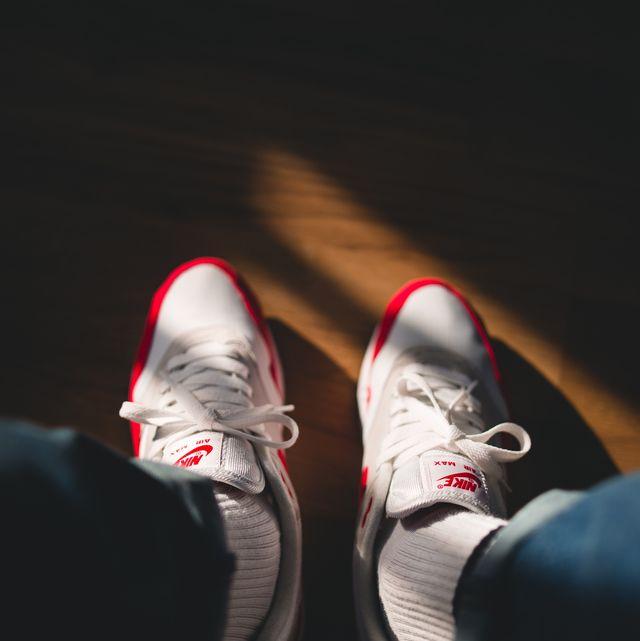 Footwear, Shoe, Red, Leg, Sneakers, Athletic shoe, Carmine, Sportswear, Human leg, Ankle,