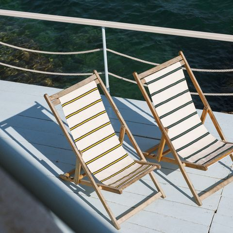 young  lovely outdoor fabric by dedar on deckchairs