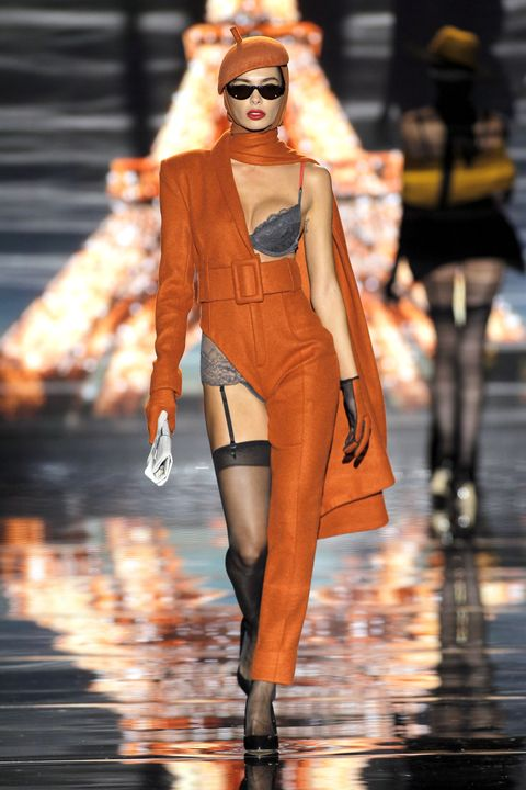Fashion model, Fashion, Fashion show, Clothing, Runway, Street fashion, Orange, Eyewear, Sunglasses, Fashion design,