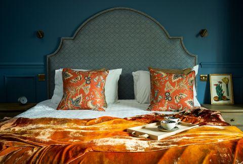 Bedroom, Bed, Furniture, Bedding, Orange, Room, Bed sheet, Bed frame, Interior design, Pillow,