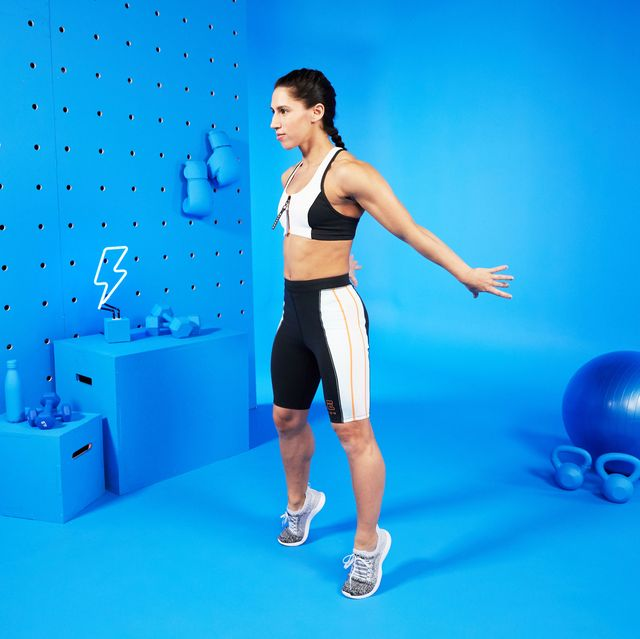 This is a picture of a female trainer doing calf raises in a studio.