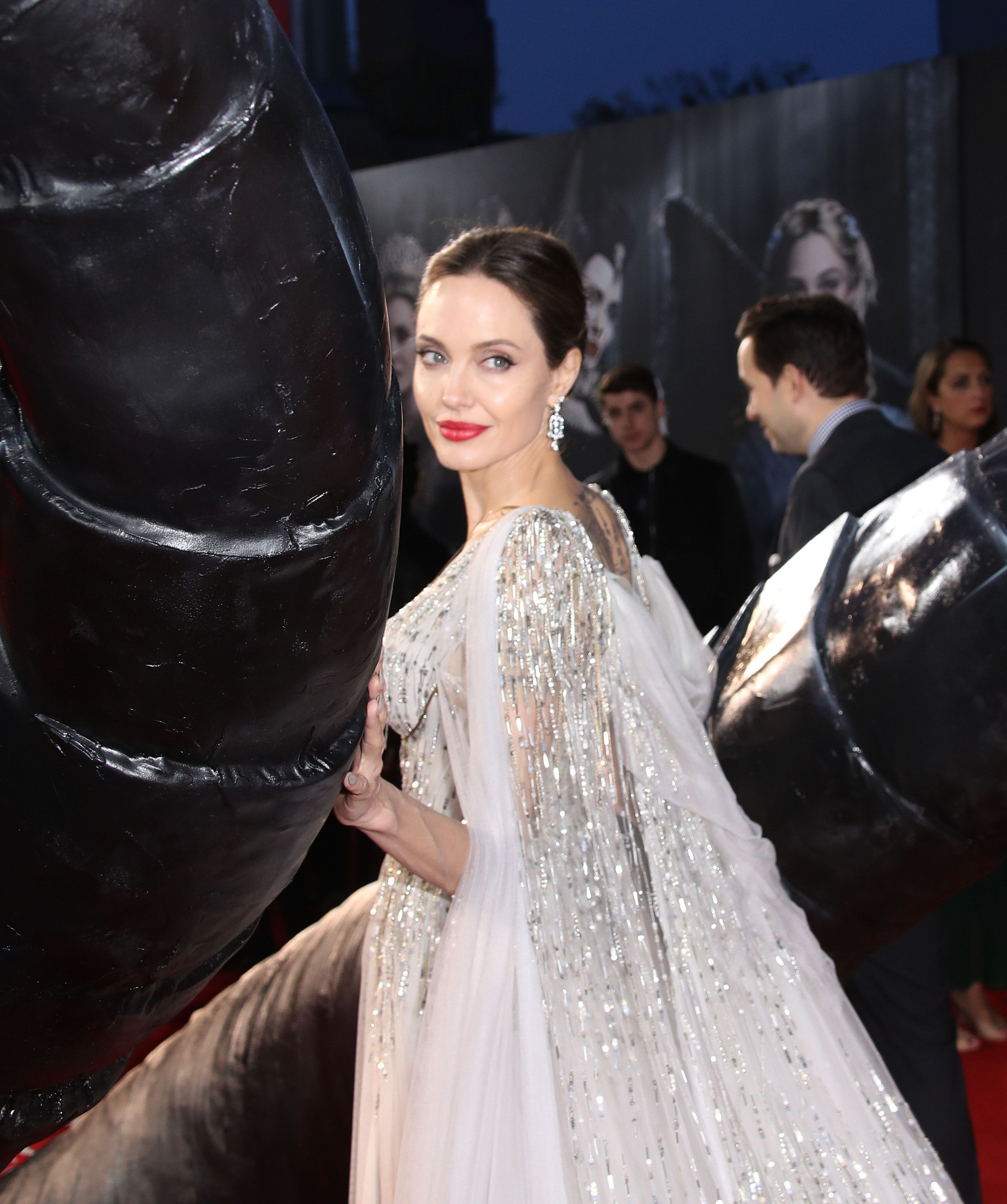 Angelina Jolie Wears A White Gown To Maleficent London Premiere