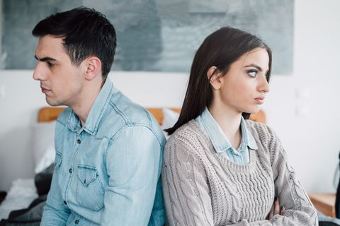angry couple sitting back to back