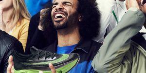 Upset fan holding Nike AlphaFly