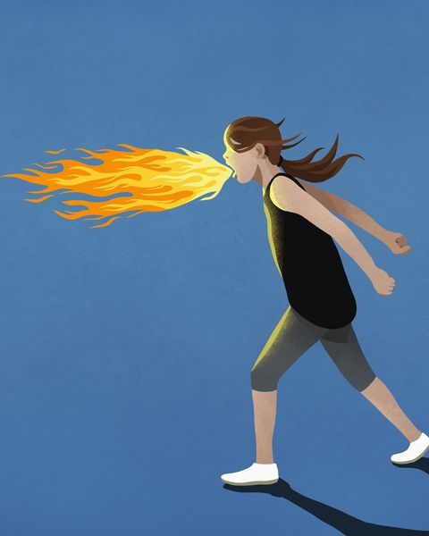 Angry girl breathing fire