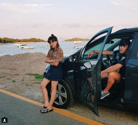 Vehicle, Car, Vehicle door, Automotive design, Street fashion, Fashion, Summer, Leg, Footwear, Photography,