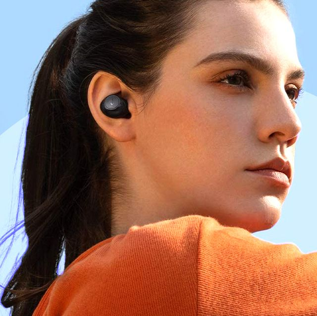 woman stretching with soundcore by anker wireless earbuds