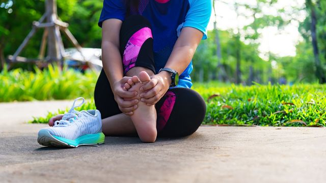 ankle sprained young woman suffering from an ankle injury while exercising and running, sports and medical concept healthcare and sport concept