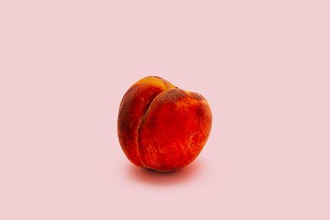 Peach on pink background
