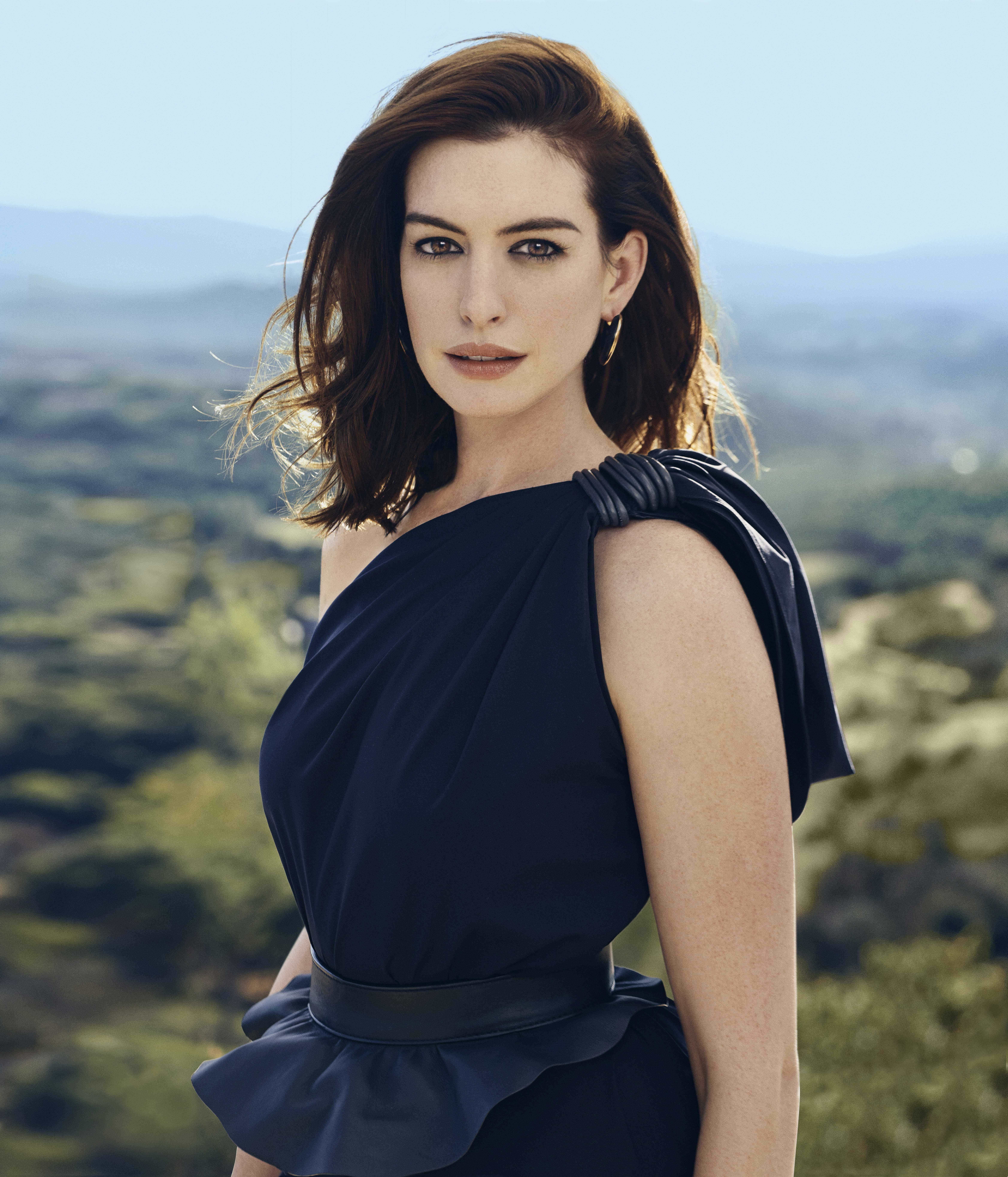 Hathaway in a MaxMara dress ($5,900) and belt ($545), Vhernier rose gold and jet earrings ($6,600).