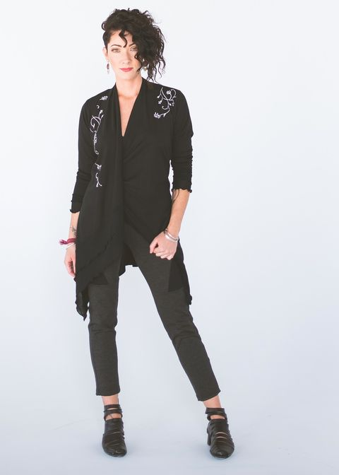 dandeneau wears her bamboo cardigan in black with a heritage design called catherine's vine