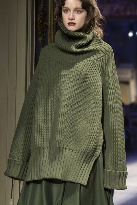 Clothing, Fashion, Fashion model, Outerwear, Woolen, Wool, Poncho, Fashion show, Sleeve, Fashion design,