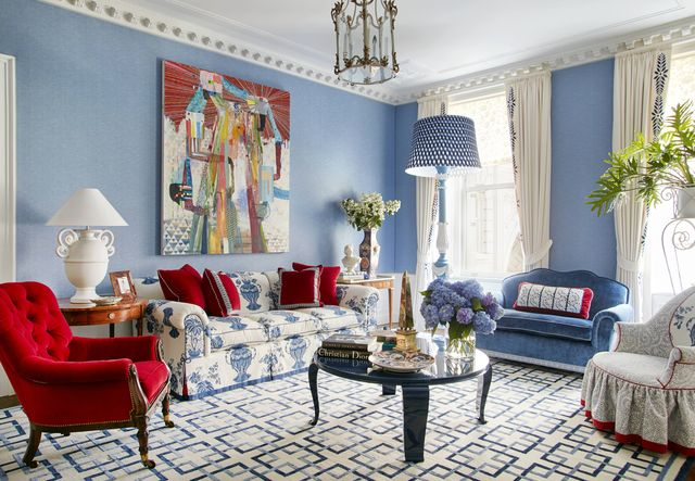 equally ample upholstered furnishings are clad in arresting colors and patterns including cherry red velvet and the sofas blockprinted linen while plaster and marble objects echo the color and classical tone of the original ceiling moldings the medallion border on the drapes was inspired by one in a christian lacroix showroom