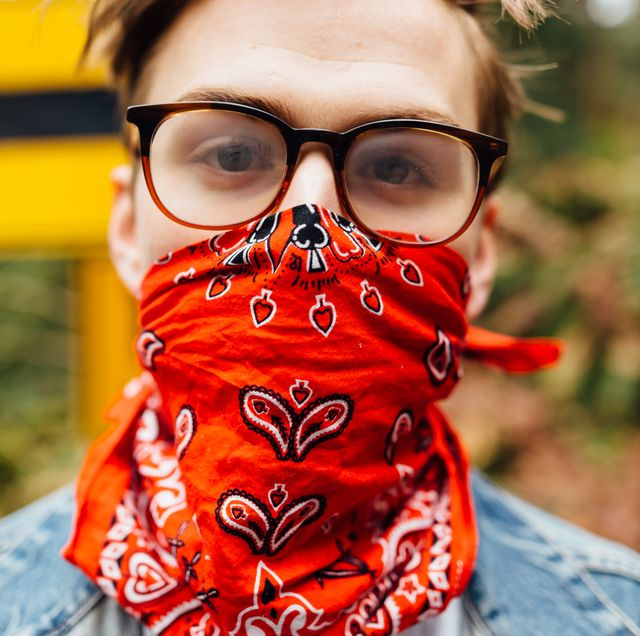 person with bandana mask wearing foggy glasses