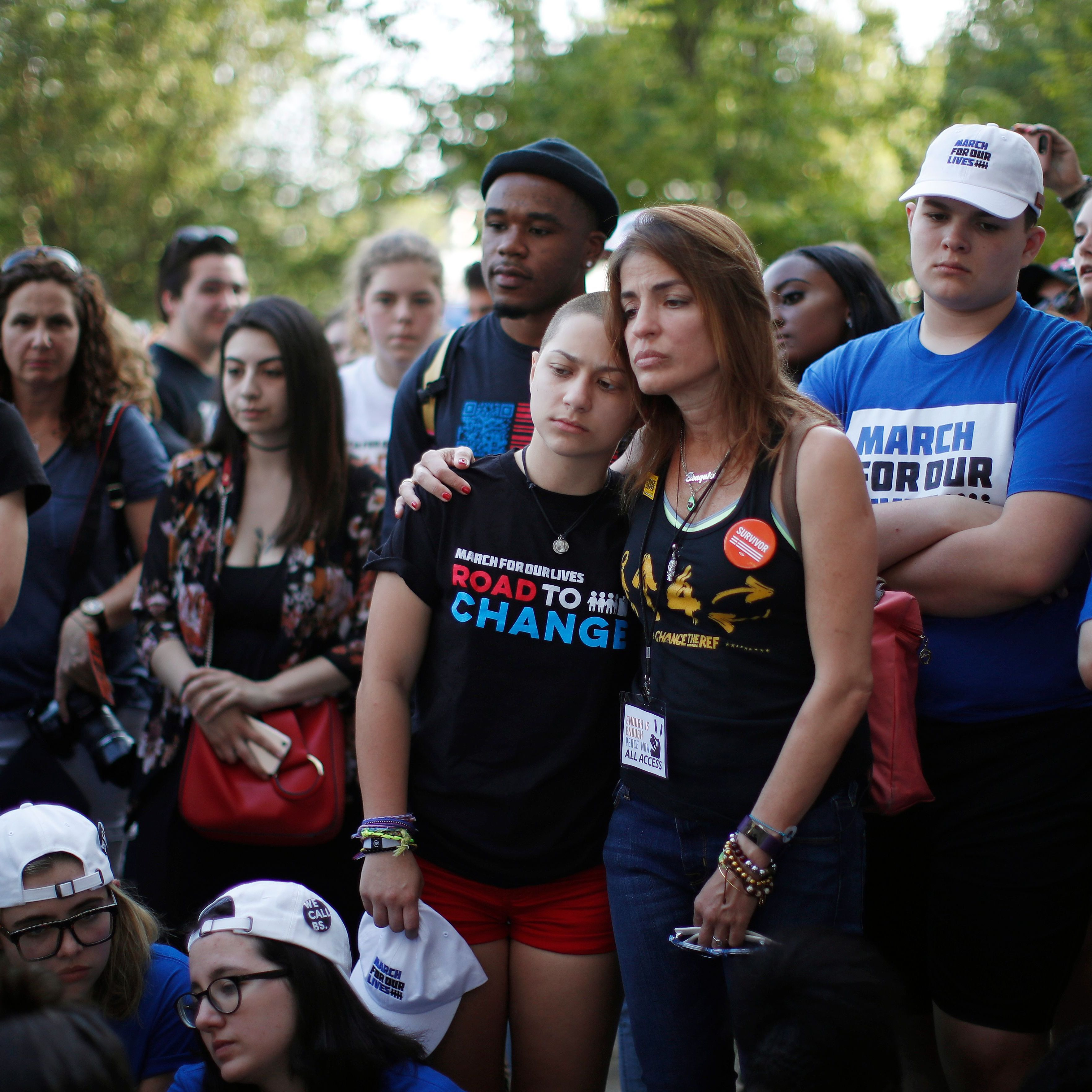 Parkland activist Emma González (left) hugs Patricia Oliver (right) at an End of School Year Peace March and Rally in Chicago on June 15, 2018. Patricia's son Joaquin was killed in the Parkland shooting.