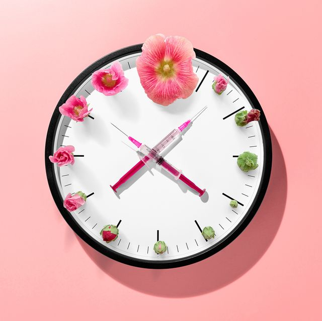 syringes as clock hand on clock face against light blue colored background front view vaccination time concept