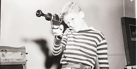 Child Takes Aim with Futuristic Toy Gun