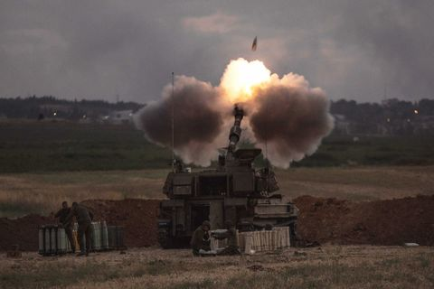 Tank firing a rocket at the dust in the grasslands