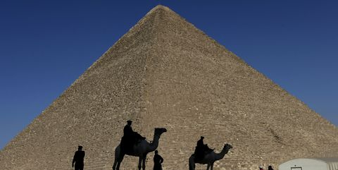 Camel, Pyramid, Camelid, Monument, Arabian camel, Sky, Historic site, Ancient history, Unesco world heritage site, Wonders of the world,