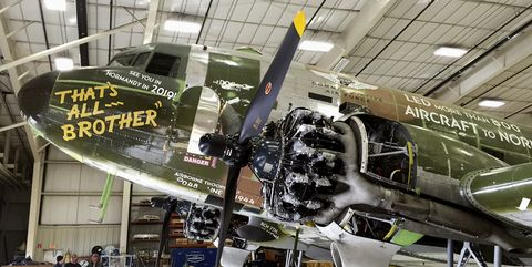 Airplane, Aircraft, Vehicle, Hangar, Aerospace engineering, Aviation, Propeller-driven aircraft, Museum, Tourist attraction, Propeller,