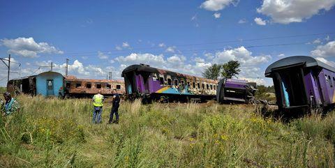 Transport, Railway, Train, Sky, Vehicle, Mode of transport, Rolling stock, Rural area, Graffiti, Railroad car,