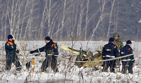 Personnel work at the scene of the AN-148 plane crash in Stepanovskoye village, about 40 kilometers (25 miles) from the Domodedovo airport, Russia, Moday, Feb. 12, 2018.