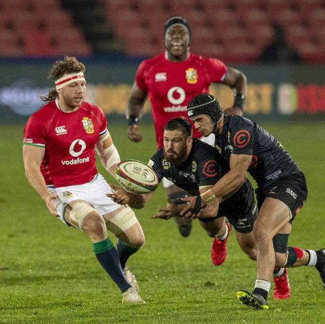 south african sharks marius louw, middle, catches the ball as british and irish lions hamish watson, left, watches on during a warm up rugby match between south africas sharks and british and irish lions at ellis park stadium in johannesburg, south africa, wednesday, july 7, 2021 ap photothemba hadebe