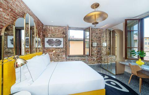 Bedroom, Room, Furniture, Bed, Property, Yellow, Interior design, Bed frame, Building, Bed sheet,