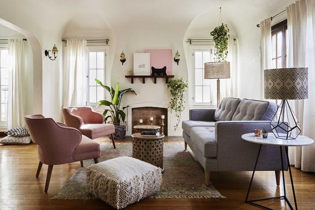 white living room, white curtains, gray couch with pink lounge chairs
