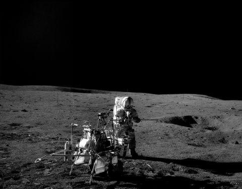 Apollo 14 mission. Astronaut Alan Shepard near Modular Equipment Transporter (MET) on lunar surface.