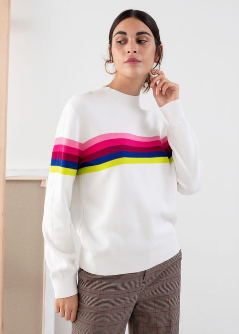 White, Clothing, Shoulder, Yellow, Sleeve, Arm, Fashion, Joint, Neck, T-shirt,