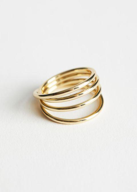 Jewellery, Ring, Fashion accessory, Metal, Body jewelry, Gold, Wedding ring, Bangle, Wedding ceremony supply, Brass,