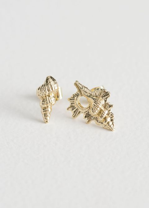 Earrings, Jewellery, Fashion accessory, Body jewelry, Leaf, Ear, Finger, Diamond, Metal, Silver,