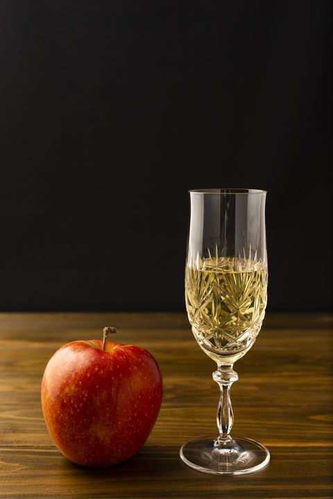 Apple and sparkling apple wine on black background