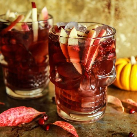 spiced apple cider pomegranate moscow mules in skeleton glasses