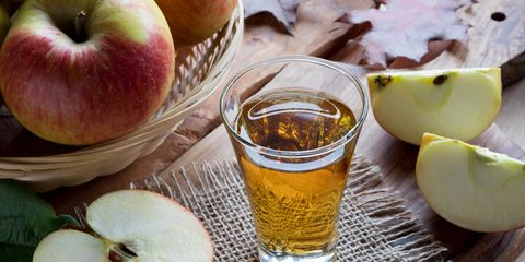 Apple cider vinegar in a glass on a wooden table