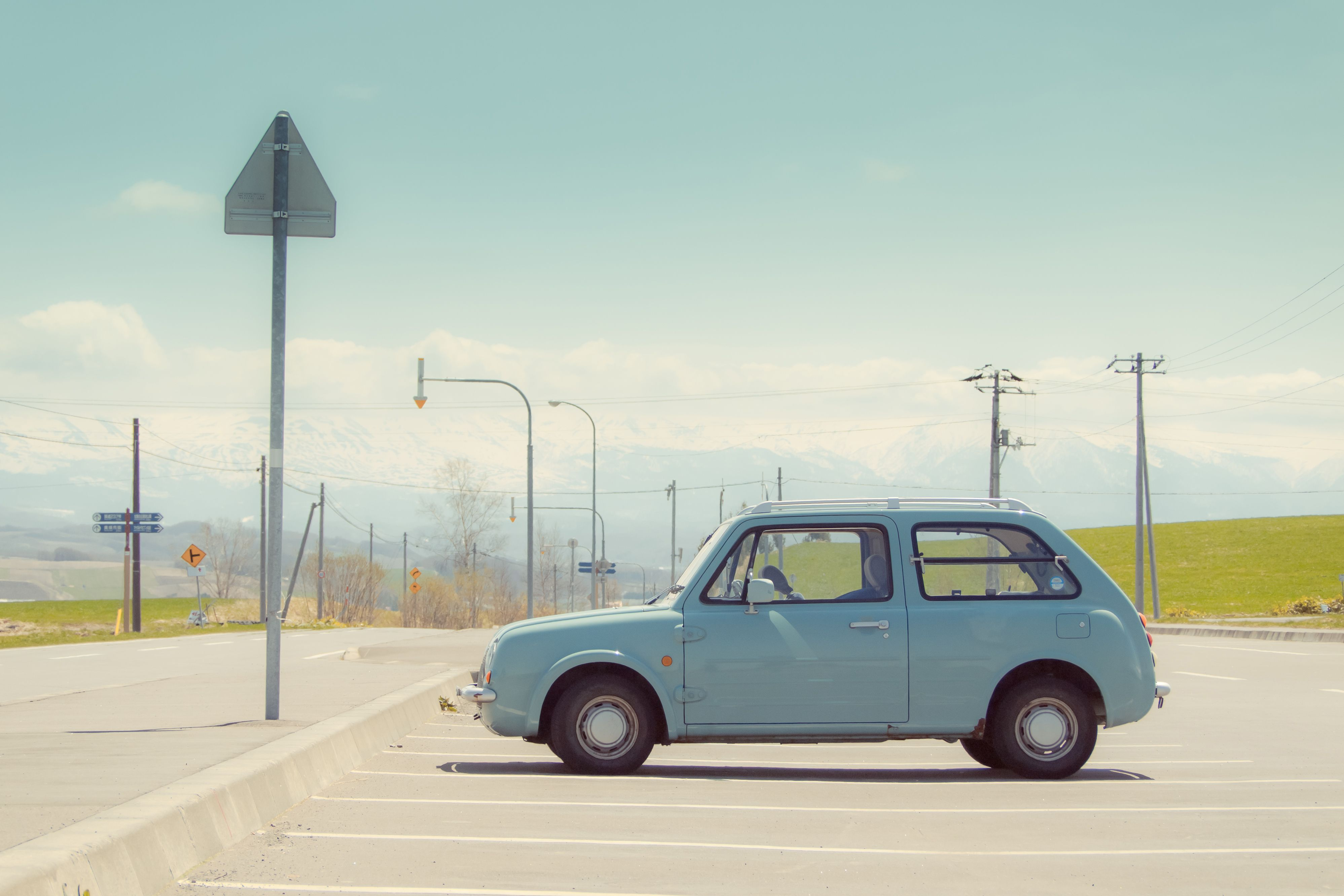 Aqua color car in parking lot