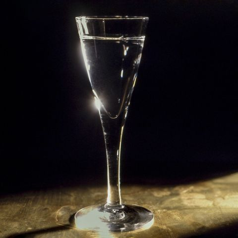 aquavit drink in glass on table