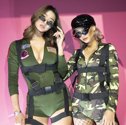 Fashion, Eyewear, Performance, Fashion model, Pink, Fashion design, Model, Camouflage, Thigh, Uniform,