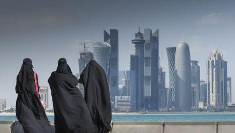 Arab women watching futuristic city