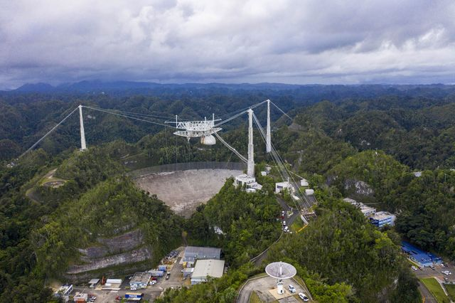 this aerial view shows the arecibo observatory in arecibo, puerto rico on november 19, 2020   the national science foundation nsf announced on november 19, 2020, it will decommission the radio telescope following two cable breaks in recent months which have brought the structure to near collapse photo by ricardo arduengo  afp photo by ricardo arduengoafp via getty images