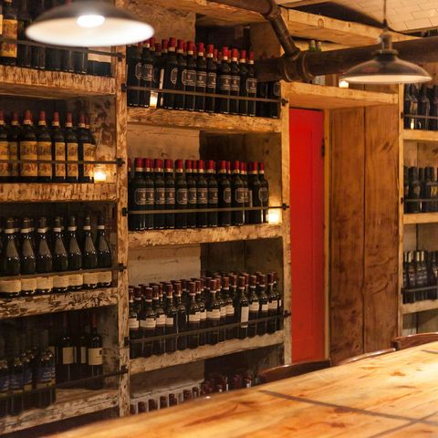 Wine cellar, Winery, Liquor store, Building, Wine rack, Furniture, Wine, Drink, Distilled beverage, Inventory,