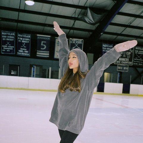 Ice skating, Ice rink, Recreation, Skating, Winter, Sportswear, Ice, Ice skate, Sports equipment, Building,